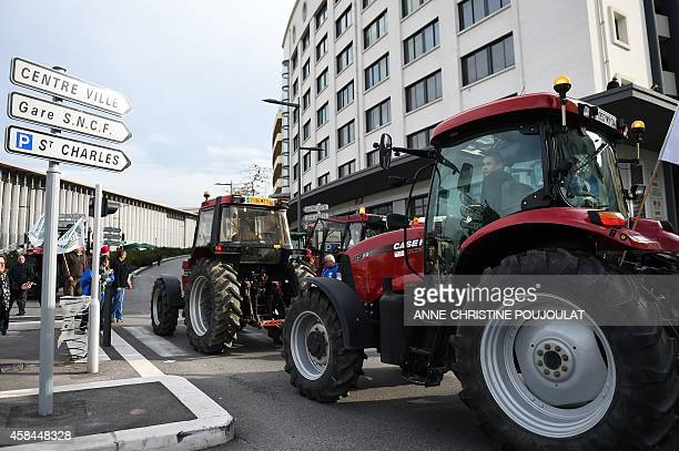 French farmers enter in the French southern city of Marseille with tractors on November 5 at the start of a demonstration to protest especially...