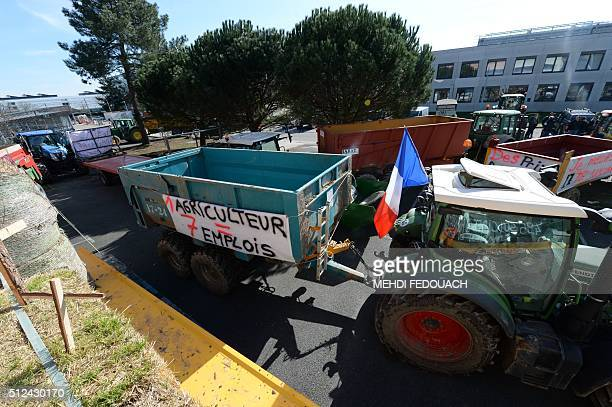 French farmers from Dordogne demonstrate with trucks and tractors in front of the headquarters of Ardia in Talence on February 26 to denounce...