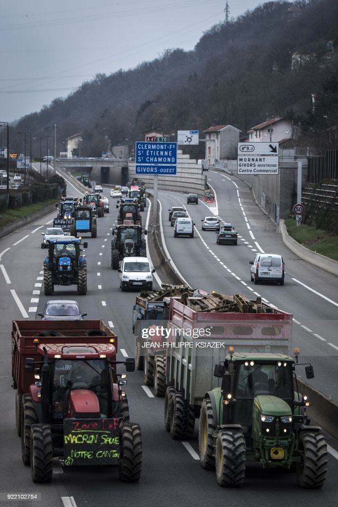 French farmers in tractors block the A47 highway near Lyon during a demonstration on February 21, 2018 to protest against the negotiations between Mercosur and the European Union and the revision of the map of disadvantaged areas through which certain communes receive aid. Negotiators from Mercosur and the European Union are due to resume talks on February 21 after edging closer to a historic trade deal during the last round in Brussels. /