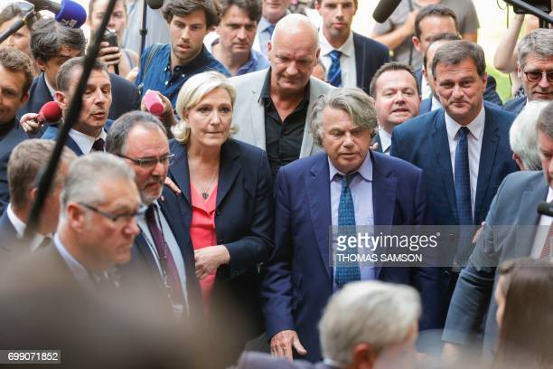 French farrigh Front National party's newly elected Members of Parliament Marine Le Pen Gilbert Collard Louis Aliot and Bruno Bilde escorted by...