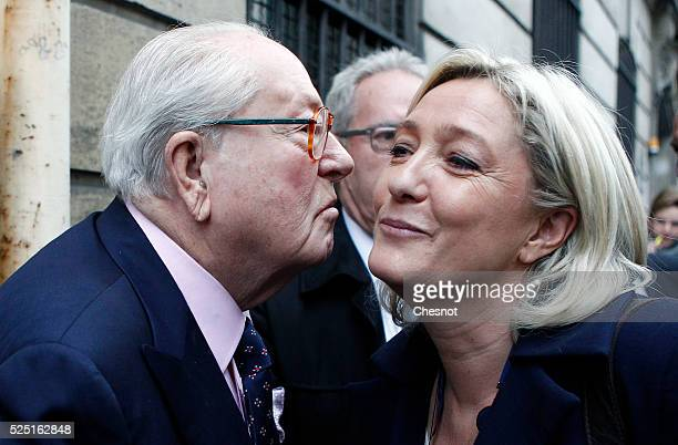 French farright FN party president Marine Le Pen kisses her father JeanMarie Le Pen as she arrives at the Ministry of the Interior in Paris on April...