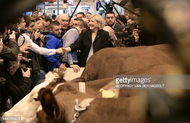TOPSHOT French farright Front National party candidate for the presidential election Marine Le Pen visits the Agriculture Fair in Paris on February...