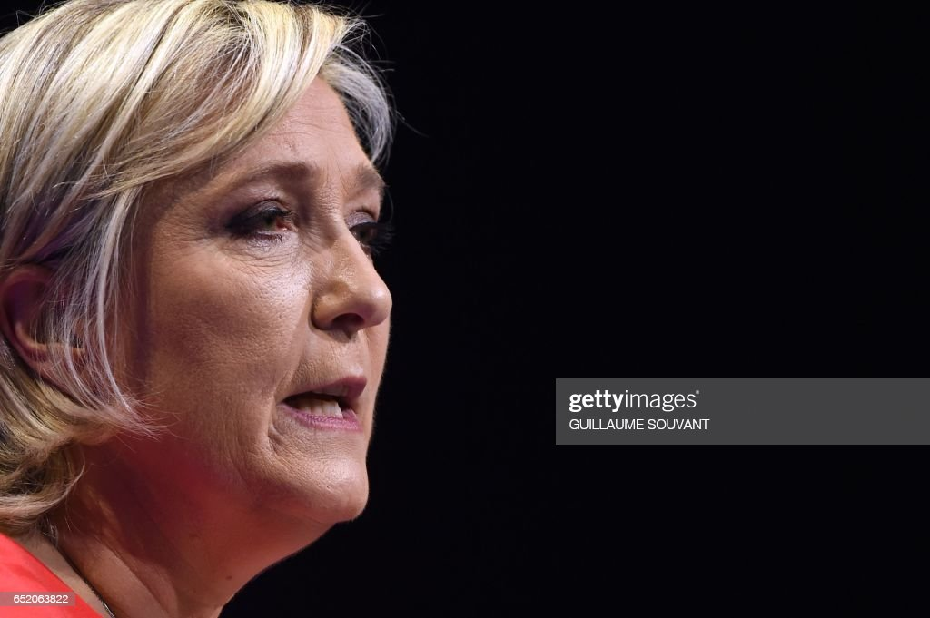 French far-right Front National (FN) party candidate for the presidential election Marine Le Pen delivers a speech during a campaign rally on March 11, 2017 in Deols, central France. /
