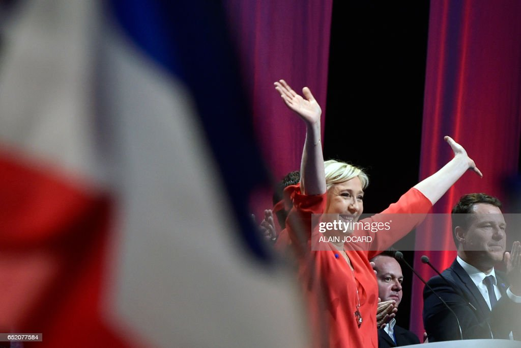 French far-right Front National (FN) party candidate for the presidential election Marine Le Pen reacts after delivering a speech during a campaign rally on March 11, 2017 in Deols, central France. /