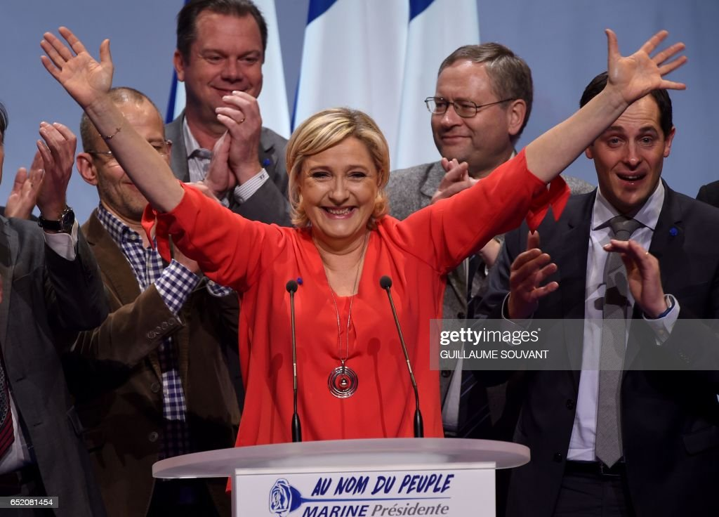 French far-right Front National (FN) party candidate for the presidential election Marine Le Pen gestures after delivering a speech during a campaign rally on March 11, 2017 in Deols, central France. /