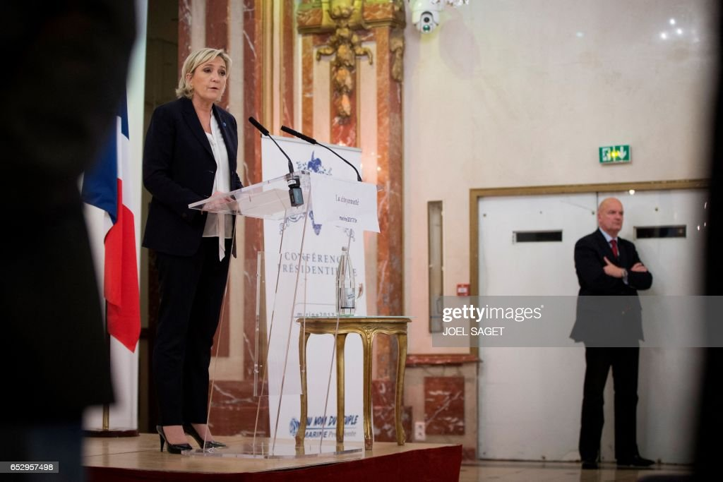 French far-right Front National (FN) party candidate for the presidential election Marine Le Pen surrounded by security staff speaks during a conference focused on 'citizenship' in Paris, on March 13, 2017. /