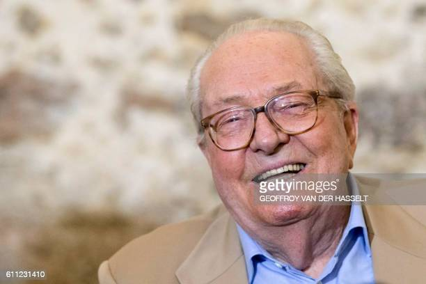 French farright Front National party founder and former leader JeanMarie Le Pen smiles as he delivers a speech during a press conference for the...