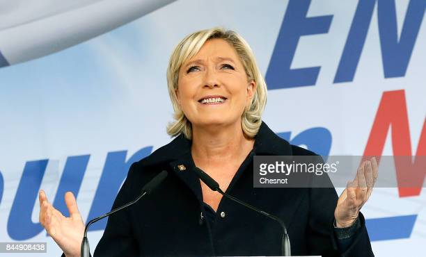 French farright Front National party President and member of French parliament Marine Le Pen delivers a speech during a political rally on September...