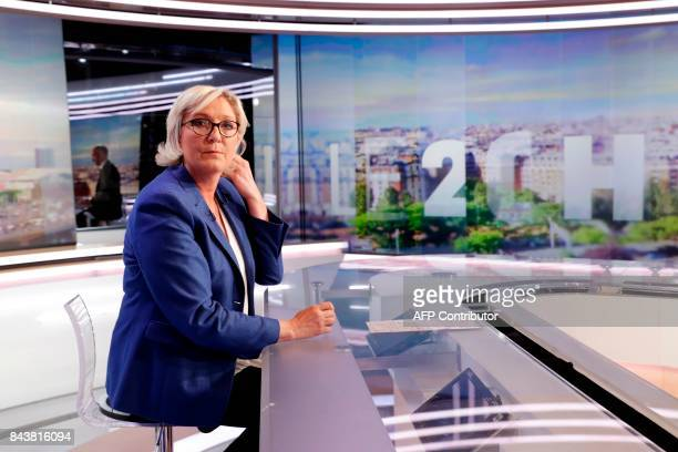 French farright Front National party president and member of parliament Marine Le Pen poses before a transmission of the French television program...