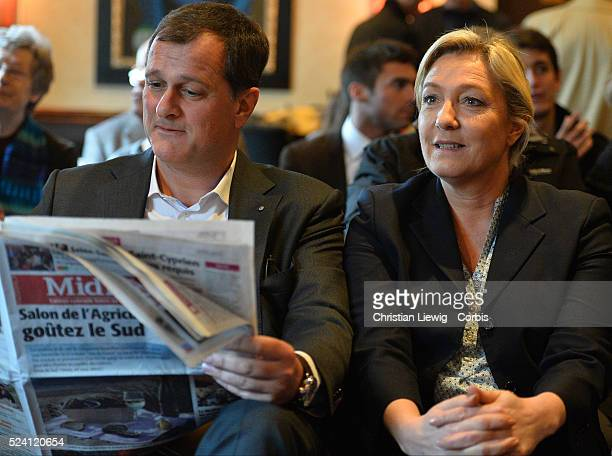 French farright Front National party president Marine le Pen and her companion party vicepresident Louis Aliot during a press conference hosted by...