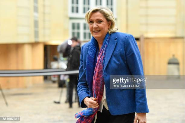 French farright Front National party president Marine Le Pen arrives for a meeting with the French Prime Minister on November 29 2017 at the Hotel...