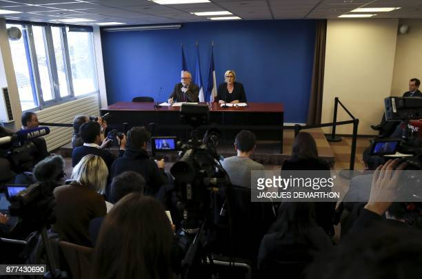 French farright Front National party president Marine Le Pen flanked by FN party member Wallerand de SaintJust speaks during a press conference...