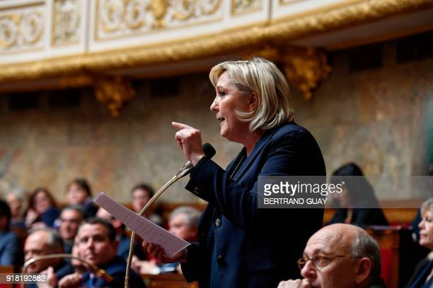 French farright Front National party president Marine Le Pen gestures as she speaks during a session of questions to the government on February 14...