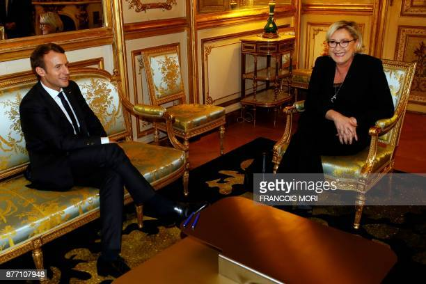 French farright Front National Party President Marine Le Pen meets French President Emmanuel Macron at the Elysee palace on November 21 2017 in Paris...