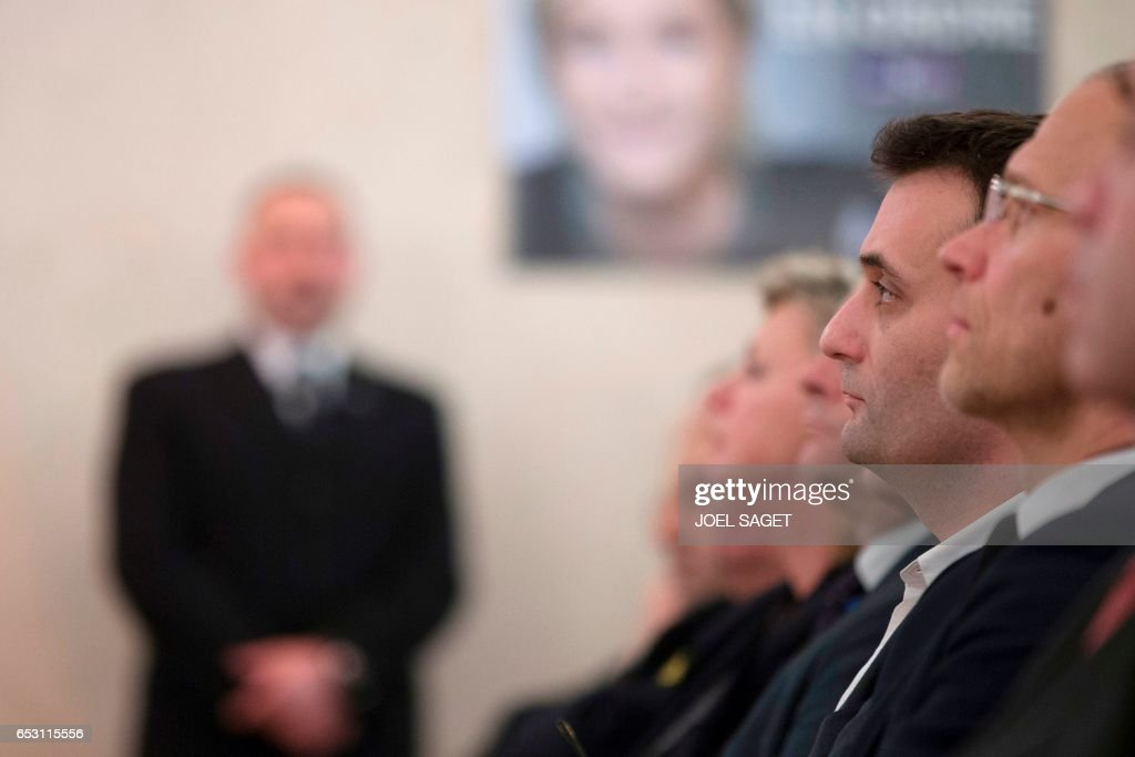 French far-right Front National (FN) party Vice-President Florian Philippot listens to the speech of the FN candidate for the presidential election during a press conference focused on 'citizenship' in Paris, on March 13, 2017. /
