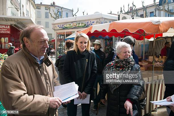French farright Front National party's MP Marion MarechalLe Pen general secretary of the FN's Vaucluse department Federation gives leaflets during a...