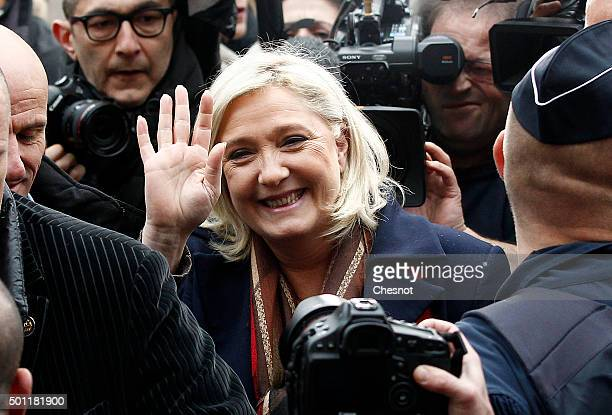 French farright Front National party's president and FN candidate for the regional election in the NordPasdeCalaisPicardie region Marine Le Pen waves...