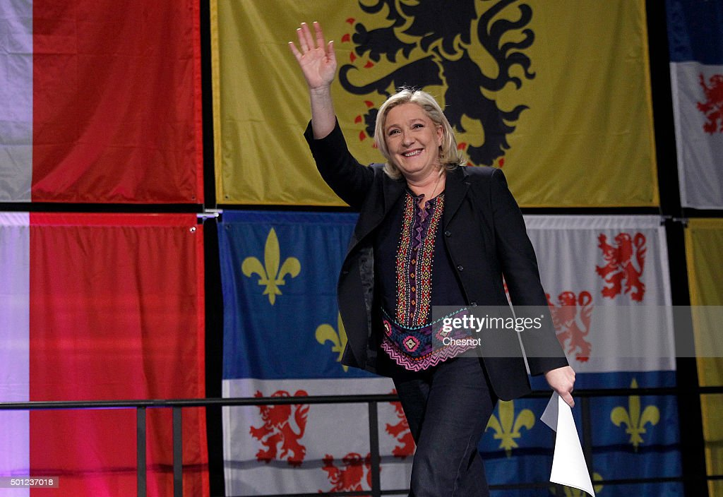 French far-right Front National (FN) party's President Marine Le Pen candidate for the regional election in the Nord-Pas-de-Calais-Picardie region arrives to make a statement after the results of the second round of the regional elections at Francois Mitterrand hall on December 13, 2015 in Henin-Beaumont, France. France's far-right National Front (FN) loses the regional elections in all the France despite record results in the first round.
