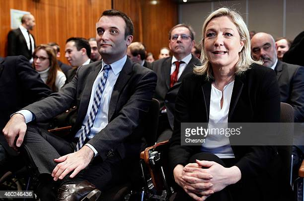 French farright Front National party's vicepresident Florian Philippot and France's farright National Front leader Marine Le Pen attend to a meeting...