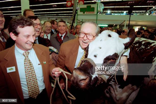 French farright Front National president and candidate for the upcoming presidential election JeanMarie Le Pen hugs a cow during his visit at the...