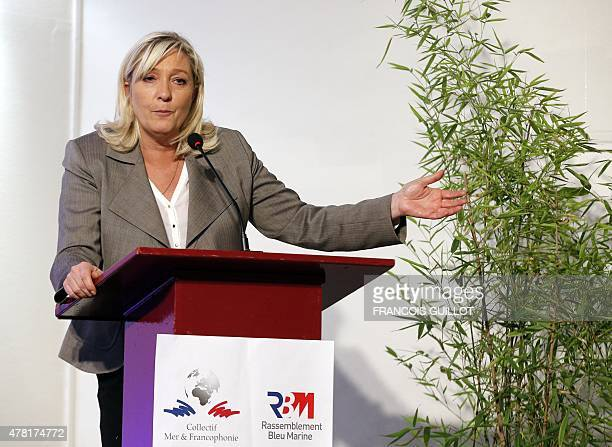 "French far-right leader Marine Le Pen delivers a speech on June 23, 2015 in Paris during the launching of the collective ""Sea and Francophone..."