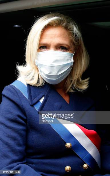 French farright leader Marine le Pen wearing a protective face mask leaves after participating in a ceremony in honor of Joan of Arc as the lockdown...