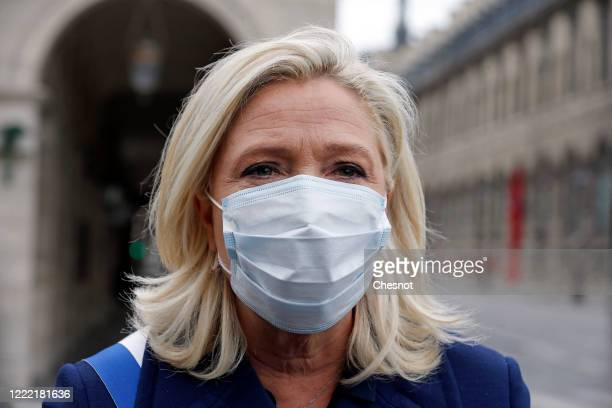 French farright leader Marine le Pen wearing a protective face mask participates in a ceremony in honor of Joan of Arc as the lockdown continues due...