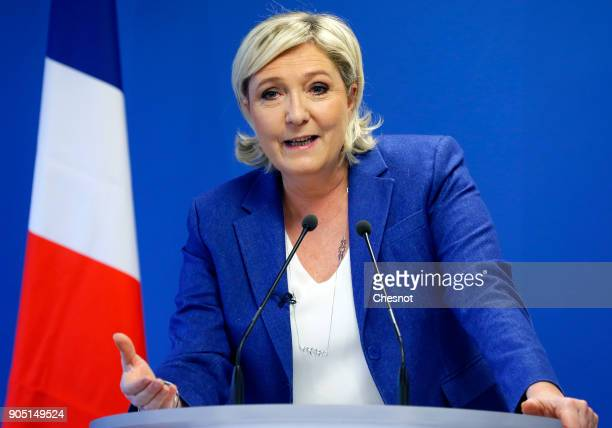 French farright National Front political party leader Marine Le Pen delivers her New Year wishes to the media at the party's headquarters on January...