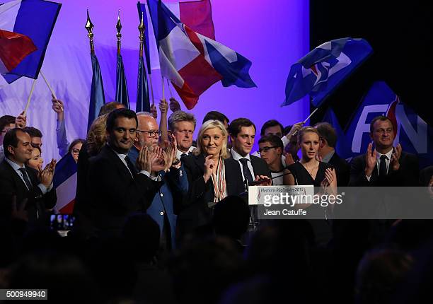 French farright National Front President and candidate in the NordPasdeCalais Picardie region Marine Le Pen is surrounded by regional candidates...