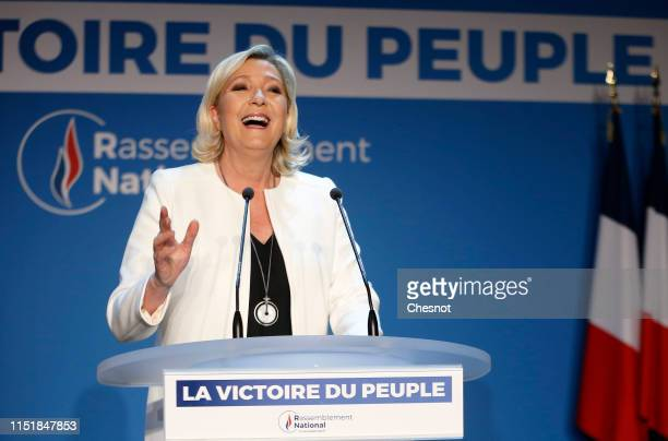 French farRight National Rally political party leader Marine Le Pen makes a statement after the projections for the results of the European...