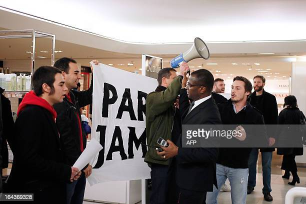 French far-right organization Bloc Identitaire leader Fabrice Robert holds up his loudspeaker as a security guard tries to intervene during a...