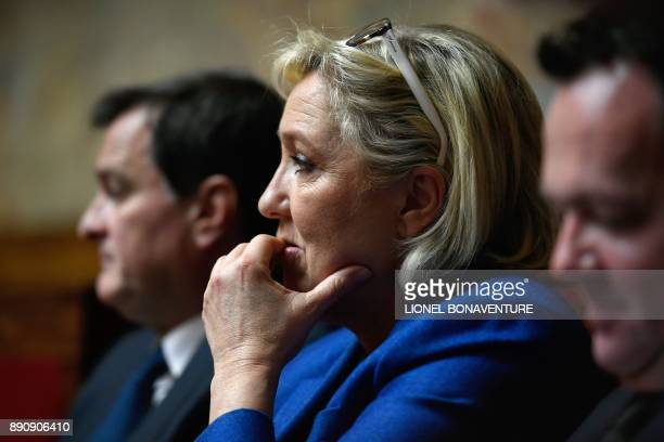French farright party Front National deputy Marine Le Pen attends a session of questions to the Government on December 12 2017 at the National...