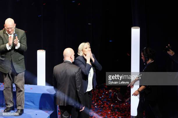 French farright party Front National president Marine Le Pen waves after delivering the closing speech of her party's congress on March 11 2018 in...