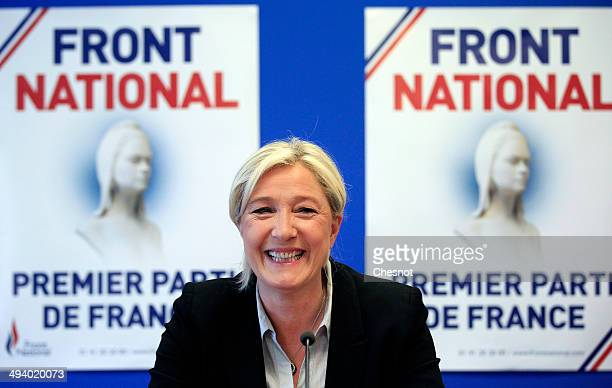 French farright party National Front president Marine Le Pen delivers a speech during a press conference at the party's headquarters on May 27 2014...