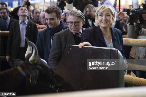 French farright political Party National Front Leader and Presidential candidate Marine Le Pen and her VicePresident Florian Philippot visit Le Salon...