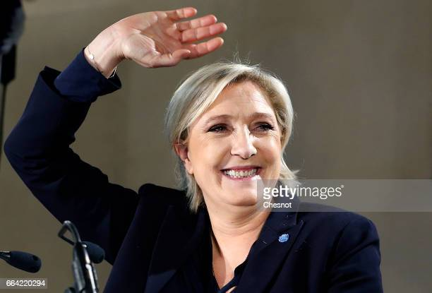 French farright political party National Front President Marine Le Pen waves after her speech during a campaign rally on April 03 2017 in La...