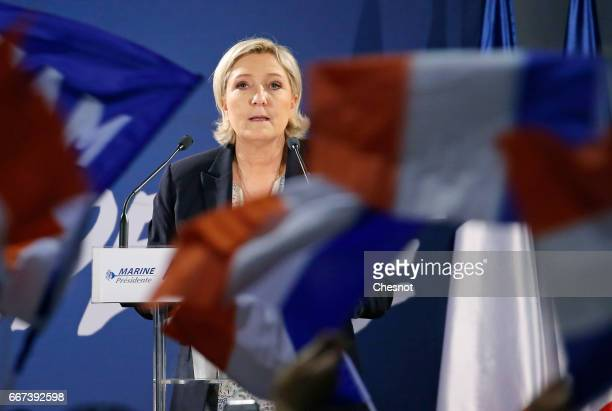 French farright political party National Front President Marine Le Pen delivers a speech during a campaign rally on April 11 2017 in ArcissurAube...