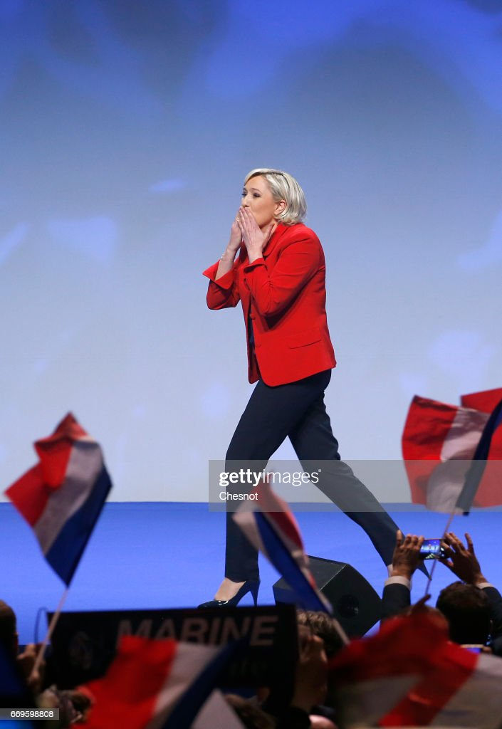 French far-right political party National Front (FN) President, Marine Le Pen waves to supporters during a campaign rally on April 17, 2017 in Paris, France. Le Pen is candidate for the France's 2017 presidential elections and polls predict his presence in the second round of this election on May 07.