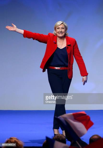 French farright political party National Front President Marine Le Pen waves to supporters during a campaign rally on April 17 2017 in Paris France...