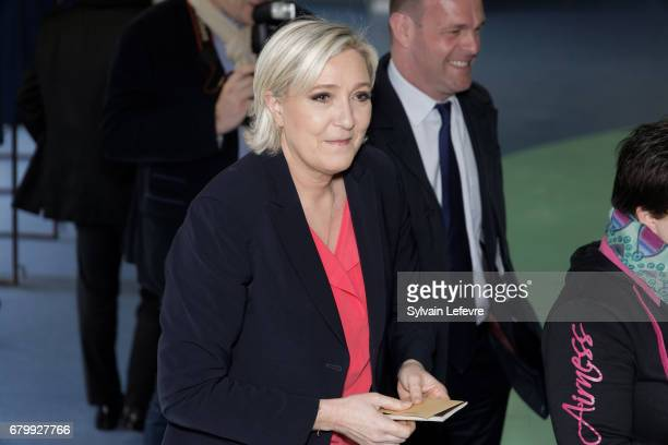 French farright presidential candidate Marine Le Pen waits to vote for the 2nd round in a polling station on May 7 2017 in HeninBeaumont France...