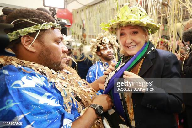 French farright Rassemblement National party president Marine le Pen is welcomed at the New Caledonia stall during a visit at the 2019 Agriculture...
