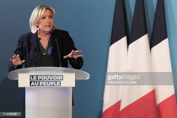 French farright Rassemblement National party president Marine Le Pen speaks on stage during a political rally for the European elections on May 16...