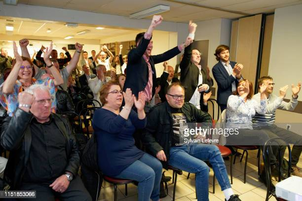 French farright Rassemblement National supporters react after the announcement of initial results during an RN electionnight event for European...