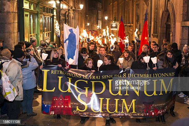 """French far-right supporters take part in a torch-lit rally called """"Lugdunum Suum"""", on December 8, 2012 in Lyon, eastern France, at the call of """"Les..."""