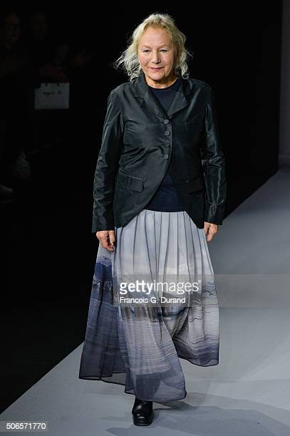 French fashion designer Agnes B acknowledges the public applause after the Agnes B Menswear Fall/Winter 20162017 show as part of Paris Fashion Week...