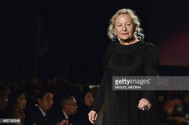 French fashion designer Agnes b acknowledges the public at the end of her 20152016 fall/winter readytowear collection fashion show on March 10 2015...
