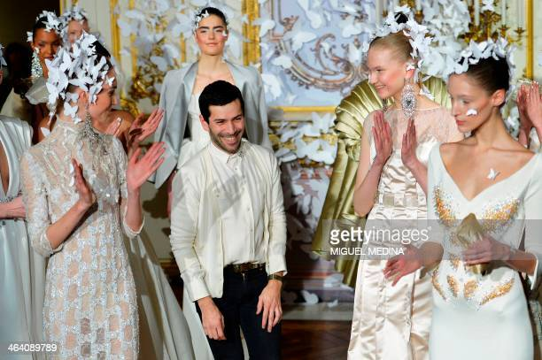 French fashion designer Alexis Mabille acknowleges the public at the end of his Haute Couture SpringSummer 2014 collection show on January 20 2014 in...