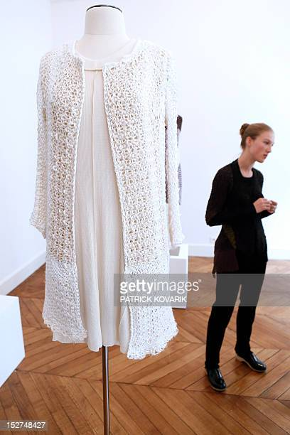French fashion designer Alice Lemoine stands next to one of her creation during Le Moine Tricote Spring/Summer 2013 readytowear presentation on...