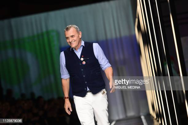 French fashion designer and new artistic director of Italian fashion house Benetton JeanCharles de Castelbajac acknowledges applause following the...
