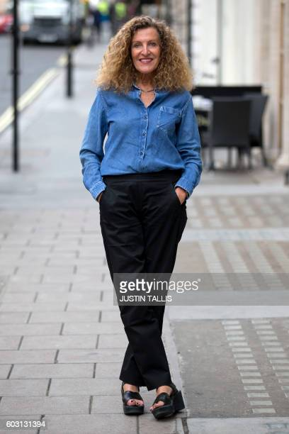 French fashion designer and sculptor Nicole Farhi poses during a photocall to promote her new sculpture exhibition The Human Hand in London on...